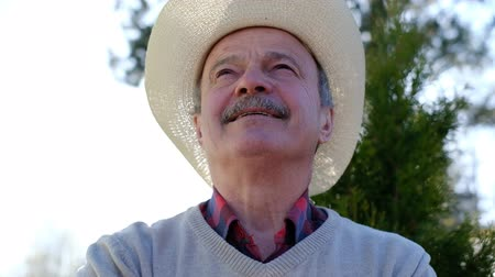 Spanish senior man in hat relaxing outdoor