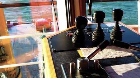 Winch control levers on bridge of tug. Close-up view.