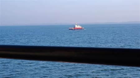 curso : View of boat from tugs deck on clear day