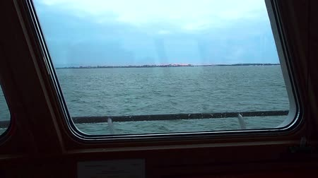 navigasyon : View of calm turquoise sea and coast through window of ship. Clear day. Stok Video