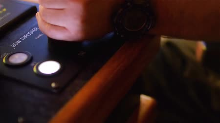 retailer : Tug master controls bow thruster. Close-up of hands in a low light Stock Footage