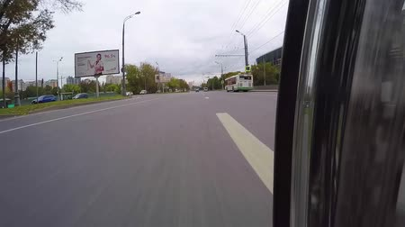 crossway : MOSCOW. RUSSIA - September 2016. Motorcycle is moving around the city. The camera is located at lower asphalt Stock Footage