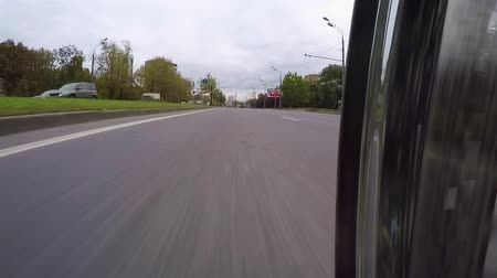 crossway : MOSCOW. RUSSIA - September 2016. Motorcycle moves around the city. The camera is close to roadway Stock Footage