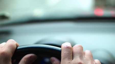 урод : Mens hands nervously hit the steering wheel of the car in a traffic jam. Close-up