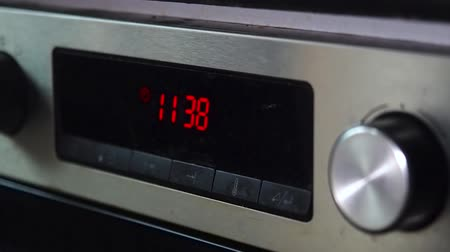 kitchenware : Red digital clock on an old oven Stock Footage