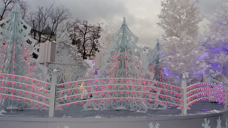 canto : Beautiful white Christmas scene with trees and large decorations Stock Footage