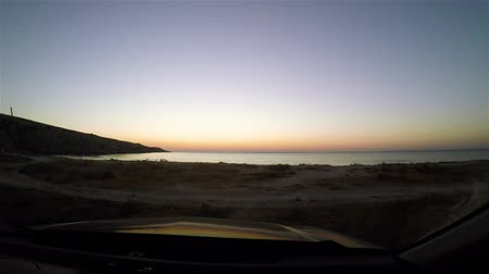 time laps : Time-lapse of sunrise from the sea shoot from windshield of car.