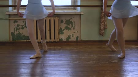 third world : Two girls in ballet shoes do exercises during ballet class in frayed classroom Stock Footage