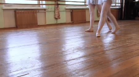 third world : Four pairs of ballerinas do exercises during ballet class in ballet classroom.