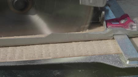 обрамление : Circular saw blade cuts wooden plank.