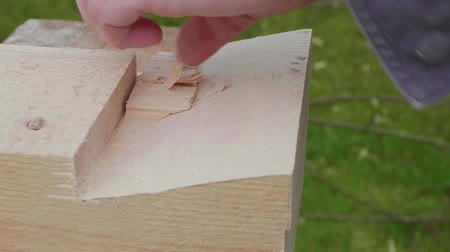 обрамление : White carpenter works with hand chisel.