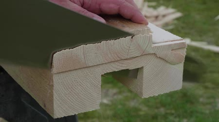 обрамление : Hands of white carpenter saw with handsaw.