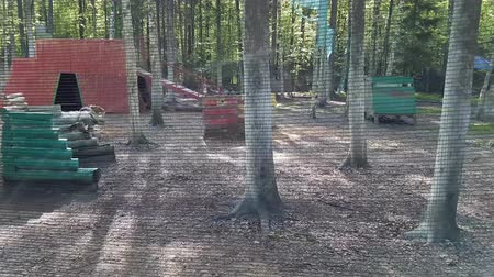 paintball : Paintball players run and shoot at each then ambush