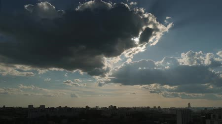 time laps : View of sky with moving clouds over big city in summer evening