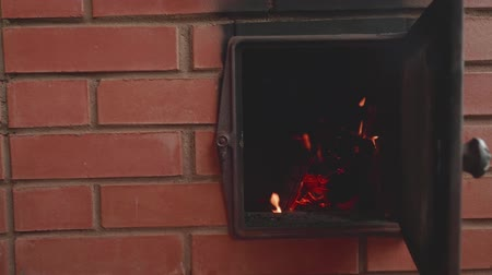 open hearth : Mans hand opens fireplace door burning fingers a little. View of flame in opened furnace. Slow motion Stock Footage