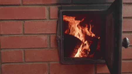 otthonos : Slow motion view of flame in furnace with door opened. Slow motion view Stock mozgókép