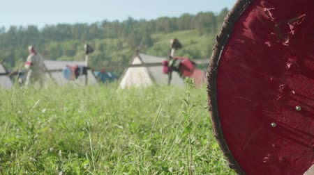 vikings : Blur of man with sward preparing for reenactment of ancient battle. Focused knights shield on the right Stock Footage