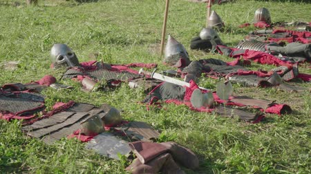 rusya : View of armor of ancient soldiers before reenactment of battle during festival