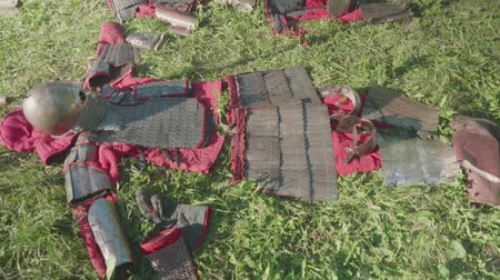 rycerze : View of armor of ancient soldiers before reenactment of battle during festival