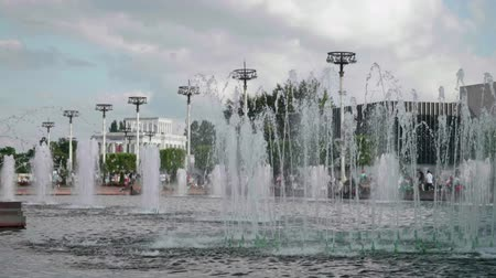 View of water jets in fountain in center of city on sunny day Stock Footage