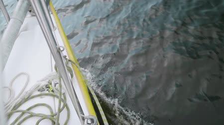 водянистый : Yacht fore shears water surface while sailing