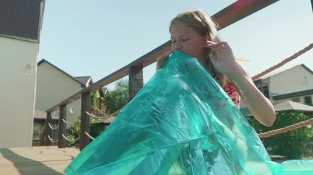 plavky : Young long-haired blonde puffs up the mattress by the pool Dostupné videozáznamy