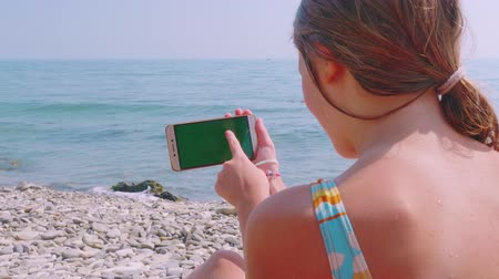 palm hands : Young blond caucasian woman running smartphone against the sea