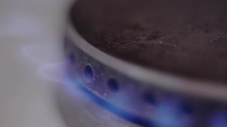 gas burner flame : Flame of natural gas begins to come out gas hob Stock Footage