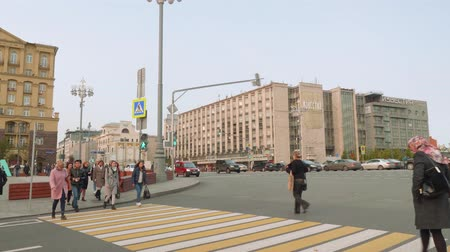 crossway : MOSCOW - CIRCA NOVEMBER 2017: People crossing street at crossway near busy road