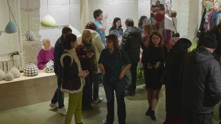 ethnography : MOSCOW - CIRCA OCTOBER 2017: People walk and talk during exhibition Stock Footage