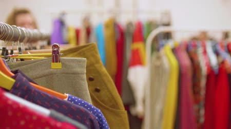 pitcher : Row of dresses hanging on hangers with blur background