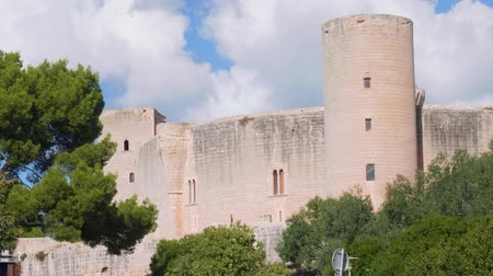 baleár : Front view of Bellver castle drowning in green trees in Palma de Majorca