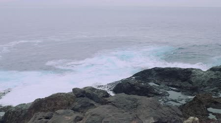 greatness : Waves of stormy sea are breaking on rocky shore. Stock Footage
