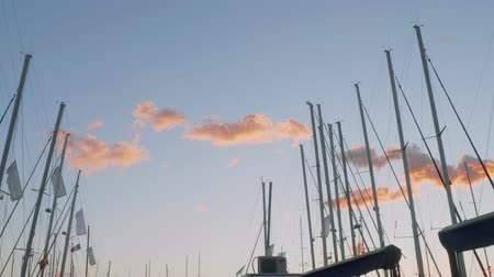 motorbot : Picturesque view of little pink clouds and masts of yachts during sunset in mallorca