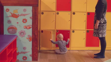 first born : Mom watches her 1 year old son closing lockers