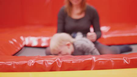 first born : Mom and toddler son have fun on trampoline