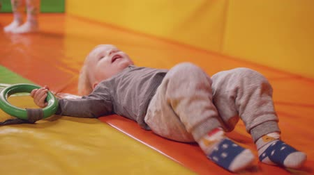 first born : Little blond boy dags tube and falls down laughing
