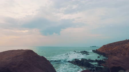 greatness : View of ocean with stony coast in evening Stock Footage