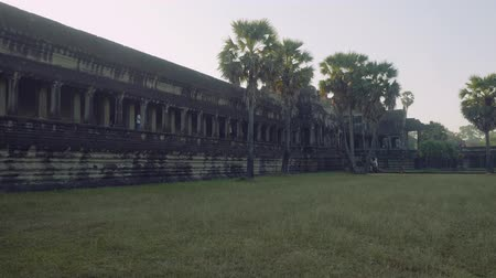 carving : Ruins of Angkor Wat temple in early morning Stock Footage