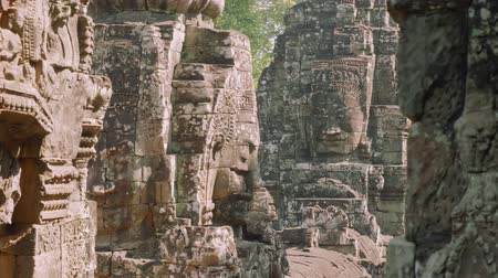 keleti : Image of Buddha recognisable in ruins of Angkor Wat temple