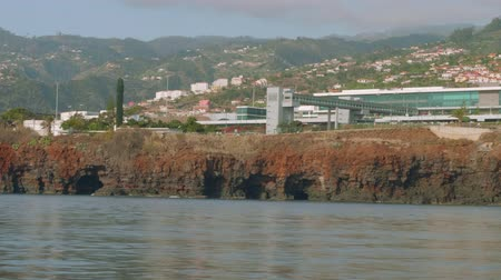crew : View of Madeira airport building. View from board of sailing yacht