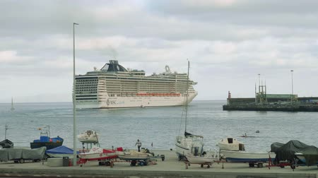 fishing village : View of cruise ship departuring from port of Funshal