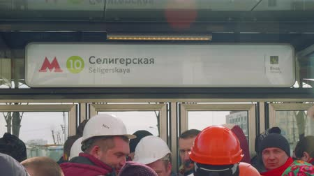 médio : View of table on entrance of new metro station with writing Seligerskaya
