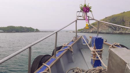 hibiscus : Viewi of cliffy shore of island Rin, Thailand. View from sailing boat with hibiscus on stempost