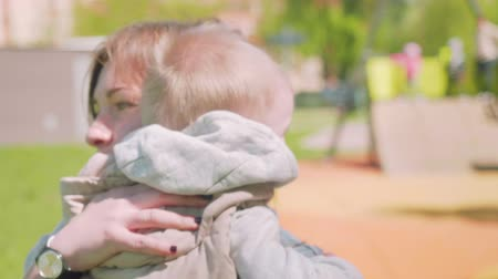 sassy : Mom solaces her toddler blond son when he cries. Slow motion view. Stock Footage