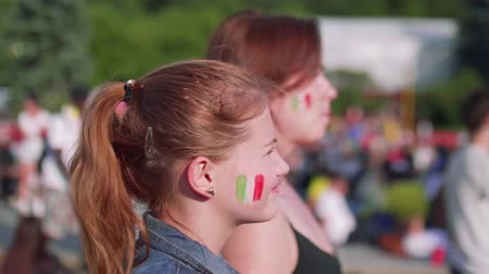 fan fest : Girls with Mexican flag on cheeks watch game