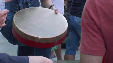 Fans hand beats drum. Close up view