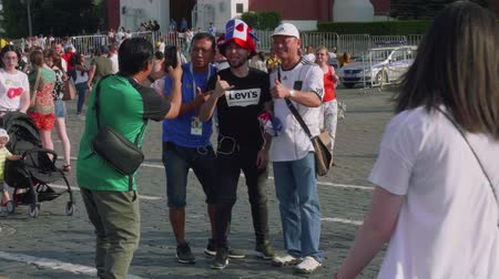 fan zone : Football fans make photos on Red Square in Moscow Stock Footage
