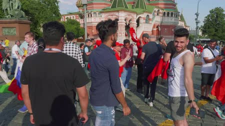fan zone : Tourists and football fans walk on Red square in moscow