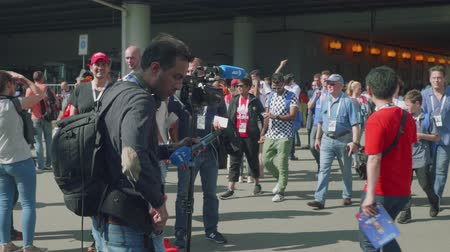 fan fest : MOSCOW - CIRCA JULY, 2018: View of camera crew ready to interview football fans